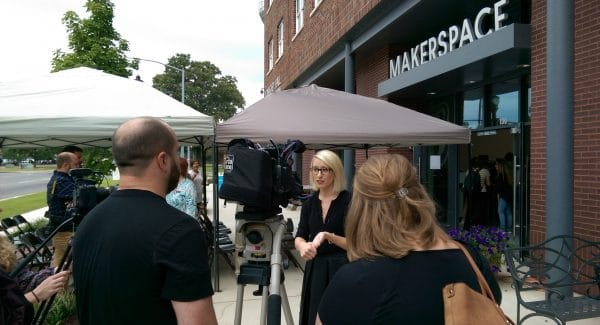 Kim Lane visits with the media about the launch of the Makerspace