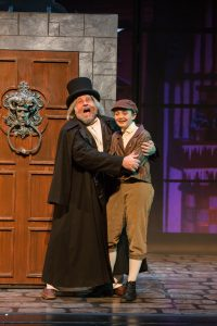 Scott H. Severance as Ebenezer Scrooge and young cast member