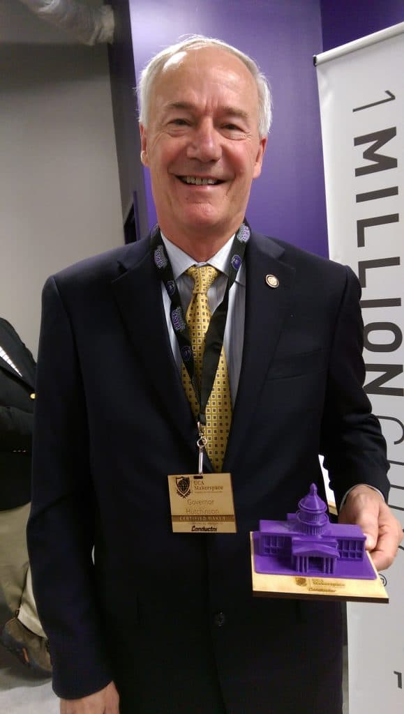Governor Huthchinson shows off his gifts from the Makerspace